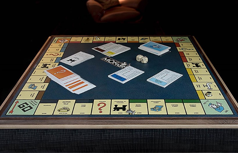 The board of the classic Monopoly game with cards and dice